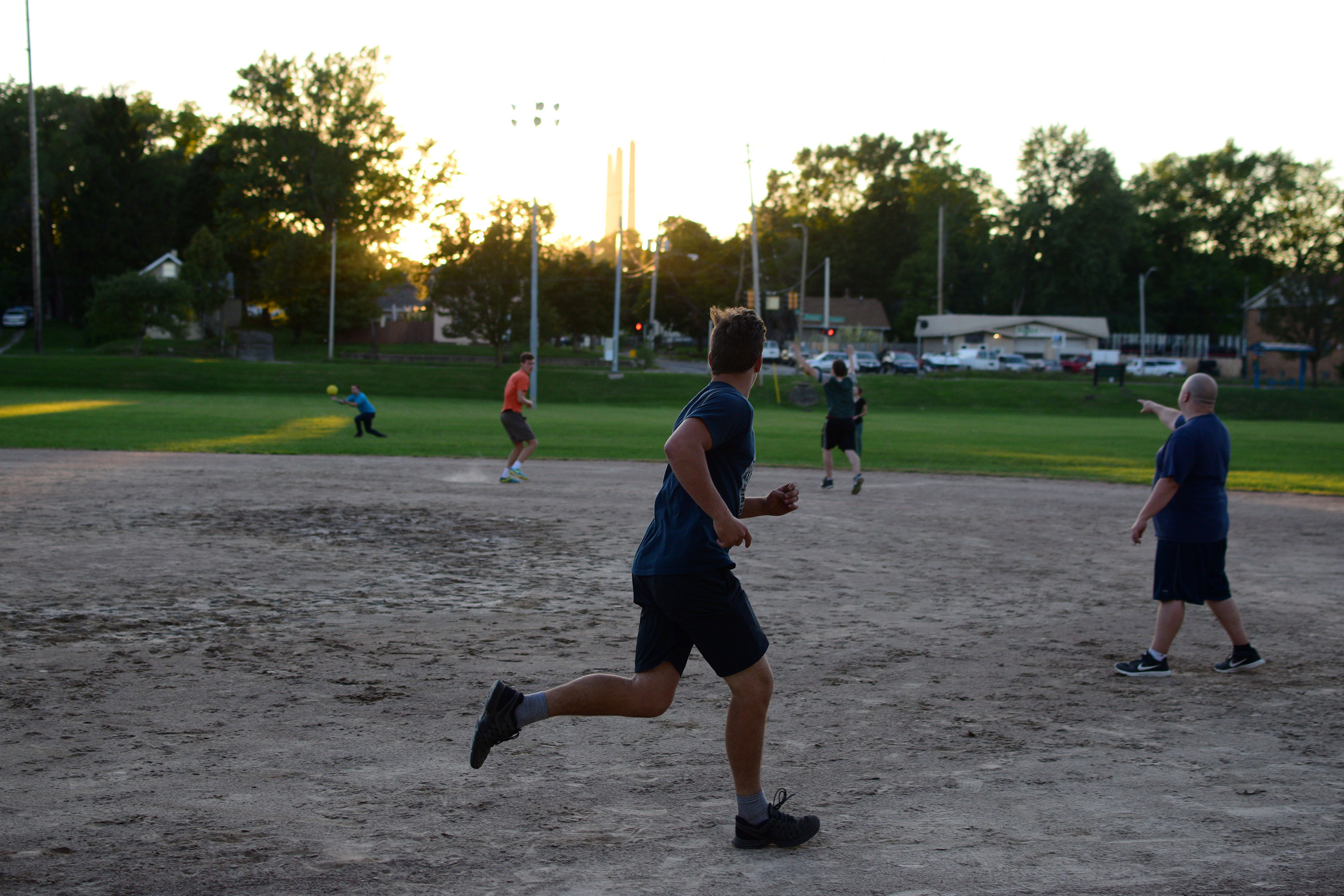 Playing kickball in Sycamore park with Cody's group