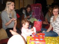 Kendall opening her first birthday gifts