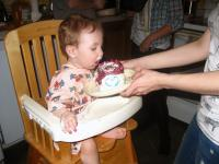 Kendall eating her first birthday cake