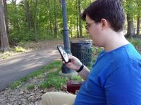 Hunter checking his phone during a walk