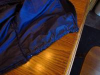 Pleating the top of the cloak