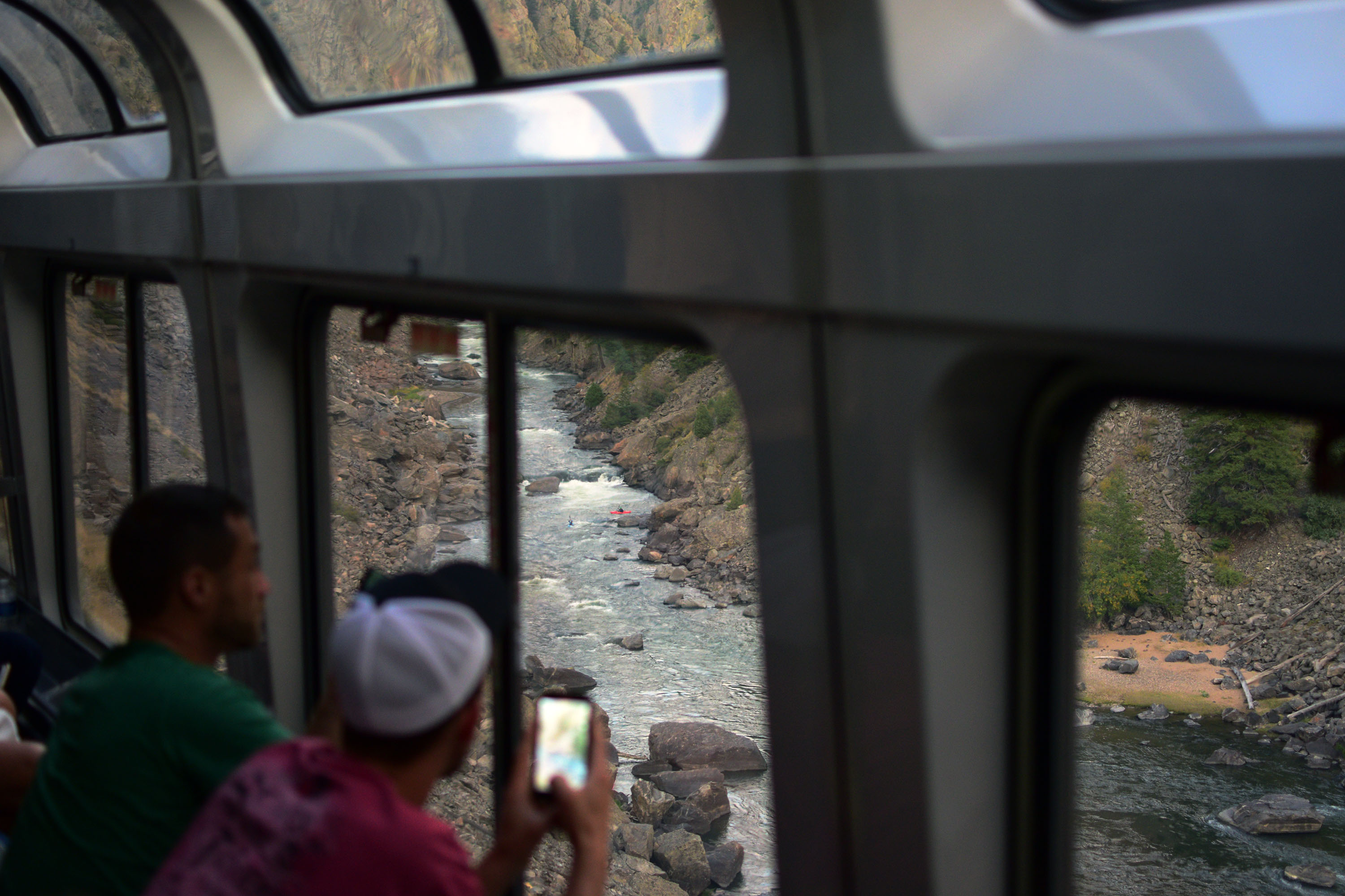 Colorado River whitewater rapids as seen from inside the California Zephyr observation car